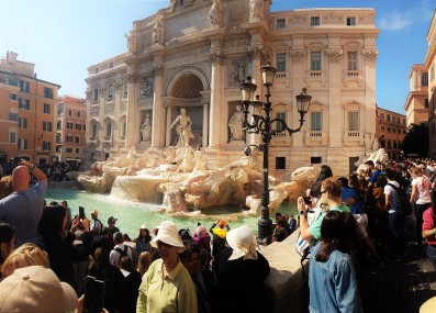 Fontana di Trevi, me in the green t-shirt on right.