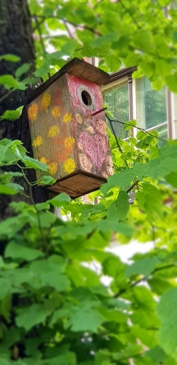 This bird house must be filled with love.
